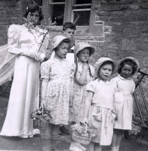Group of Milton children early 1950s. Girl with arm raised is Marily Watkins
