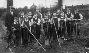Shipton School gardening class 1910. The elderly man is Mr Strong the headmaster.